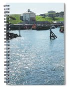 sunlight glistening on water at Eyemouth harbour Spiral Notebook