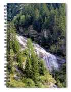 Waterfall In The Mountains. Spiral Notebook