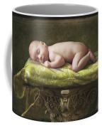 A Baby Asleep On A Pillar Coffee Mug