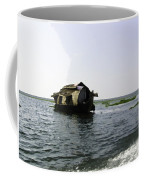 A Houseboat Moving Placidly Through A Coastal Lagoon In Alleppey Coffee Mug