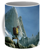 A Man Backpacks In Front Of Fitz Roy Coffee Mug