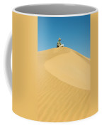 A Man Sits Atop A Dun In The Namib Coffee Mug