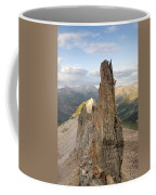 A Man Tops Out A Spire On Treasure Coffee Mug