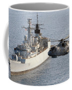 A Royal Navy Merlin Helicopter Passes Over Hms Cumberland Coffee Mug