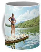 A Woman Is Standing On A Jetty Coffee Mug