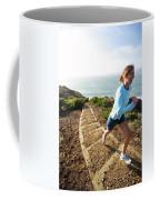 A Woman Running Stairs Near The Ocean Coffee Mug