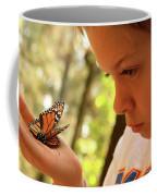 A Young Boy Holds A Stick Coffee Mug