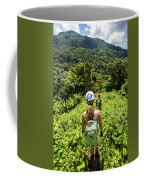 A Young Woman Hikes Through The Jungles Coffee Mug