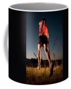 A Young Woman Runs Through A Grassy Coffee Mug