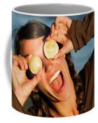 A Young Woman Smiles And Sticks Coffee Mug