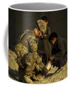 Airman Provides Medical Aid To A Local Coffee Mug