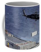 An Mh-60s Sea Hawk Helicopter Picks Coffee Mug