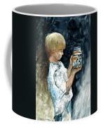 Boy Plays Coffee Mug