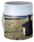 Caucasian Traveler Relaxing On Grass Outdoors Coffee Mug