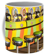 Evergreen State Fair Midway Game With Coloful Stools And Squirt  Coffee Mug