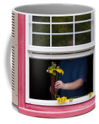 Mature Woman Cutting Flowers In Window Coffee Mug