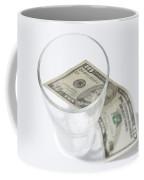 Money And A Glass Coffee Mug