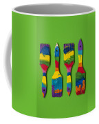 Multicolored Paint Brushes On Green Background Coffee Mug