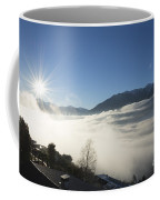 Sea Of Fog With Sunbeam Coffee Mug