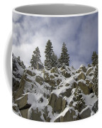 Snow Covered Cliffs And Trees Coffee Mug