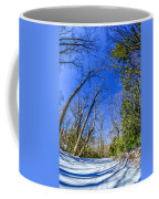 Snow Covered Road Leads Through The Wooded Forest Coffee Mug