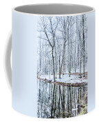 Tree Line Reflections In Lake During Winter Snow Storm Coffee Mug