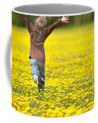 Young Boy Running Through Field Of Coffee Mug
