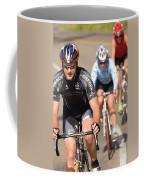 Cyclists Climb A Hill With A Mountain Coffee Mug