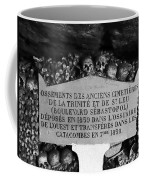 A Marker With Skulls And Bones In The Catacombs Of Paris France Coffee Mug
