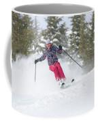 A Skier Descends A Snowy Slope Coffee Mug