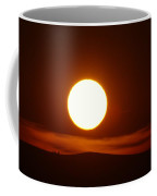 A Slow Red Sunset Coffee Mug by Jeff Swan