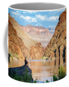 A Woman Sits By The Colorado River Coffee Mug