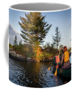 A Young Couple Paddles A Canoe On Long Coffee Mug