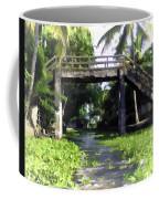 An Old Stone Bridge Over A Canal Coffee Mug