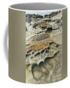 Eroded Sandstone Cliff Along The Ocean Coffee Mug