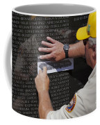 Man Getting A Rubbing Of Fallen Soldier's Name At The Vietnam War Memorial Coffee Mug