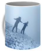 2 Men Leaning Against The Freezing Wind Coffee Mug