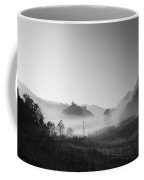 Mist In The Valley Coffee Mug by Setsiri Silapasuwanchai