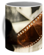 Old Film Strip And Photos Background Coffee Mug