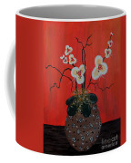 Orchids In A Pot On Orange Coffee Mug