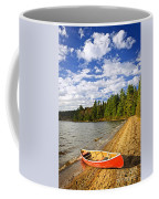 Red Canoe On Lake Shore Coffee Mug by Elena Elisseeva