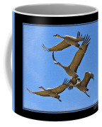 Sandhill Cranes In Flight Coffee Mug