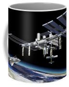 Space Station In Orbit Around Earth Coffee Mug by Leonello Calvetti