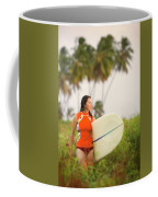 A Woman Carries A Surfboard To The Beach Coffee Mug