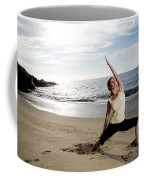 A Women At The Beach Performing Yoga Coffee Mug
