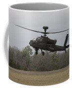 An Ah-64 Apache Helicopter In Midair Coffee Mug