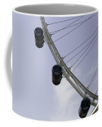 3 Capsules Of The Singapore Flyer Along With The Spokes And Base Coffee Mug