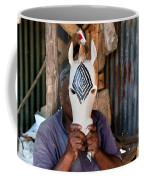 Kenya. December 10th. A Man Carving Figures In Wood. Coffee Mug