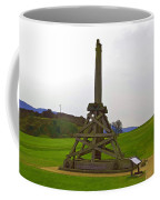 Replica Of Wooden Trebuchet And The Ruins Of The Urquhart Castle Coffee Mug