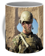 A Coalition Force Member Maintains Coffee Mug